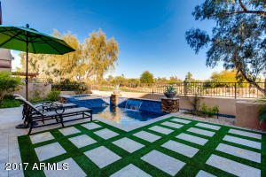 "Serene backyard with incredible golf course & mountain views! ""Swim Jet"" feature on heated swimming pool & spa, allowing for stationary lap swimming."