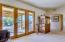 Custom french doors lead to outdoor living spaces