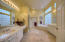 The light and bright master bathroom has been well cared for.