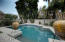 The beautiful Pebble-Tec pool w/ water feature provides entertainment and relief on those hot summer days.