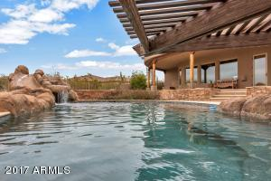 Saltwater Pool with Swim up Bar, Outdoor kitchen, Waterfall Slide, & Grotto