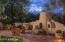 Front Courtyard at Entry with Kiva Gathering Fireplace, Seating, Landscaping for Seasonal Plantings and more