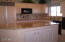 KITCHEN ISLAND WITH GRANITE COUNTER TOP