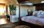 Big master suite on main level of home with private view balcony