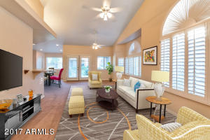 Living Room - Virtual staging to show furniture placement that you may consider if you owned this home!