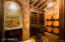 Wine cellar with wine tasting room located just off formal dining room