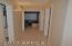 hallway to laundry, bedroom 3 & 4, and bathroom 2