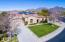 Aerial view of the front yard with views of the McDowell Mountains in the background.