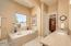 Master bathroom is beautiful and features a generous walk-in closet with custom built-in shelving and drawers.