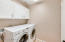 Nice sized laundry room with cabinets