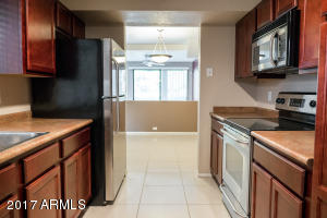 Kitchen, with stainless appliances, built-in microwave and direct entry garage.