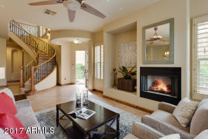 Soaring ceilings and a gas fireplace make this the perfect space to relax or entertain.