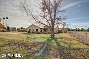 Front of home with Mature Shade and Fruit trees with over 1 Grassy Acre