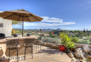 Water feature, BBQ and firepit, views included!