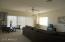 Upstairs game room/tv room/loft has Arcadia doors to balcony