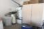 A few storage cabinets and a water softener in garage.