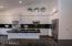 Kitchen showing island and massive storage
