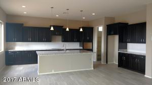A GORGEOUS kitchen that includes stainless steel appliances (dishwasher, microwave, oven and gas cooktop)... check out that HUGE island!!!