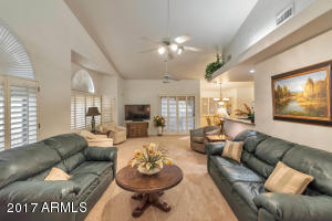 Spacious, bright and welcoming with cozy conversation areas. Soaring, vaulted ceilings add to this room's expansiveness.