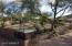 Natural desert landscape front & back of this acre lot!