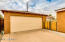 Garage includes an electric door opener, workbench & storage shelvesinside. There is a side door which goes into the back yard as well.