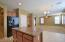 Kitchen connected to the Huge Family room and door leading to you 50ft long patio with ceiling fans and beautiful pots