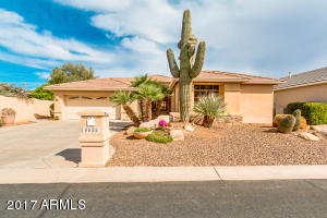 Front view with easy care desert landscaping, including a huge Saguaro cactus!