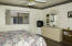 South facing windows in master bedroom, new tile flooring, ceiling fan with light,