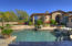 Custom Travertine surrounds the front courtyard pool and spa.