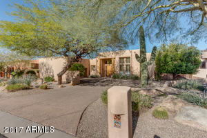 Gorgeous single level Territorial home located on Las Sendas Golf course with spectacular Red Mountain views