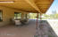 Rear patio runs the full the length of this beautiful home