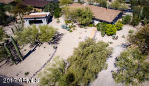 Lots of space, both front and back, is the hallmark of this oversized lot, of nearly 1/2 acre! You'll enjoy the privacy and views, both North and South. This home is situatated on the preferred exposure, of North and South. There's a private pull through on the other side for your arriving guests.