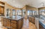 Expansive kitchen with alder wood cabinets and doors.
