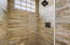 Large walk-in shower with natural light.