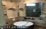 Master bathroom sink, travertine, and custom mirrors