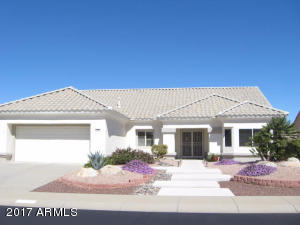 PLANTATION SHUTTERS~20' TILE~SOLID SURFACE COUNTERS~OFFICE SPACE~EXTENDED & COVERED PATIO~PRIVACY AND A PARK-LIKE SETTING