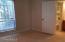 Master bedroom looking in direction of entry double door & bath on the other side of door.