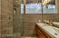 Fresh, updated master bathroom, dual sinks, wall to wall tile, frameless glass enclosure.