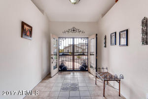 French doors welcome your family and friends to this large tiled foyer.