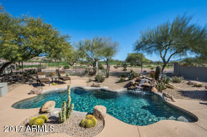 Backyard is a paradise overlooking the golf course with stunning mountain views.