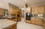 Kitchen is spacious and provides plenty of cabinetry for storage.