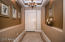entranceway with coffered ceiling