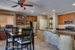 Open kitchen features tons of storage with upgraded cabinets and granite countertops.
