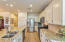 """Lots of counter space and 42"""" cabinets along with panty and island with breakfast bar!"""