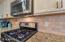 You'll love the stone tile subway tile style backsplash!
