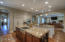 Chef's dream kitchen with built-in ovens and granite countertops