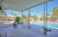 Oversized Patio overlooks the pool area and backyard!
