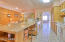 Kitchen includes granite countertops and all white appliances.