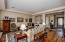 """Gorgeous Stain on Sight wood flooring with 4.5"""" baseboards."""