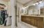 Spacious master bathroom with dual vanity sinks.